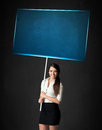 Businesswoman with blue board Royalty Free Stock Photo
