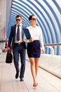 Businesswoman and a bodyguard go to business meeting Royalty Free Stock Photography