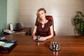 Businesswoman boss siting at office desk - smile Royalty Free Stock Photo