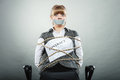 Businesswoman bound by contract with taped mouth afraid terms and conditions shut scared woman tied to chair become slave business Stock Images