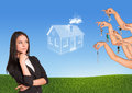 Businesswoman with brooding eyes business woman abstract house several hands offering keys nature background Royalty Free Stock Photo