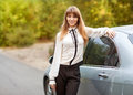 Businesswoman business travel busy with car Stock Images