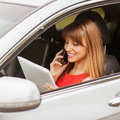 Businesswoman business travel busy with document and laptop in car Stock Image