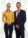 Businesswoman and businessman standing in an office Stock Photography
