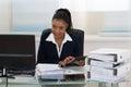 Businesswoman Calculating Bills Royalty Free Stock Photo