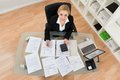 Businesswoman Calculating Invoices In Office Royalty Free Stock Photo