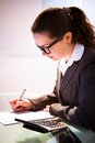 Businesswoman Calculating Tax Royalty Free Stock Photo