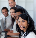 Businesswoman in a call center with her team Stock Images
