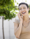 Businesswoman on call outside office cheerful young Stock Photos