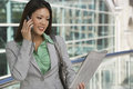 Businesswoman On Call Reading Newspaper Royalty Free Stock Photo