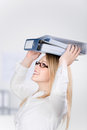 Businesswoman carrying binders on head side view of young in office Royalty Free Stock Photo