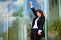 Businesswoman celebrating success happy female business school student raising her arms and her Stock Photography