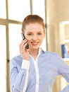 Businesswoman with cell phone bright picture of Stock Image