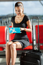 Businesswoman checking ticket smiling her flight at airport Stock Photography