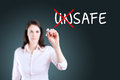 Businesswoman choosing safe instead of unsafe blue background Royalty Free Stock Images