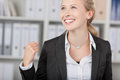 Businesswoman with clenched fist looking away happy successful in office Stock Images