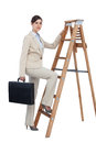 Businesswoman climbing career ladder with briefcase and looking on white background at camera Stock Image