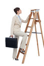 Businesswoman climbing career ladder with briefcase on white background Stock Photo