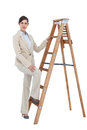 Businesswoman climbing the career ladder on white background Stock Photography