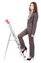 Businesswoman climbing ladder Royalty Free Stock Photo