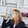 Businesswoman with clip on her nose in office mid adult Stock Photo