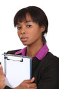 Businesswoman with clipboard a black Royalty Free Stock Photos
