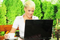 Businesswoman on coffee break young using laptop Royalty Free Stock Images