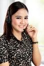 Businesswoman communicate by wireless headset Royalty Free Stock Photo