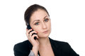 Businesswoman concentrating on cellphone call Royalty Free Stock Image