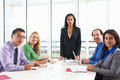 Businesswoman conducting meeting in boardroom businesswomen team Royalty Free Stock Image