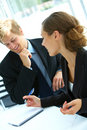 Businesswoman consulting a partner Royalty Free Stock Photos