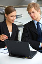 Businesswoman consulting a partner Stock Photography