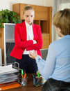 Businesswoman conversation with collegue young having serious Royalty Free Stock Image