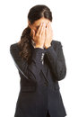 Businesswoman covering her face because of shame Royalty Free Stock Photo