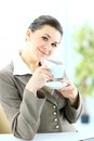 Businesswoman with cup of tea in her office Stock Photography
