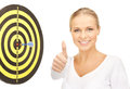 Businesswoman with dart confident and target showing thumbs up Royalty Free Stock Photos