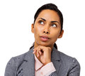 Businesswoman day dreaming against white background young with hand on chin horizontal shot Stock Photo