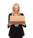 Businesswoman delivering cardboard box picture of attractive Royalty Free Stock Photo