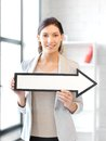 Businesswoman with direction arrow sign Stock Photos