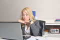 Businesswoman disapointed at work young blonde behind her laptop the office Royalty Free Stock Image