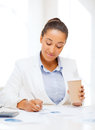 Businesswoman with documents and takeaway coffee business office school education concept Stock Photos