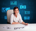Businesswoman doing paperwork with digital background futuristic backgroung Royalty Free Stock Image