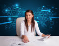 Businesswoman doing paperwork with futuristic background Stock Image