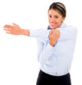 Businesswoman doing stretches exercise Stock Photo