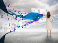 Businesswoman drawing on a paper next to paint splash with blue sky the background Stock Photos