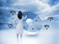 Businesswoman drawing a pie chart with blue sky on the background Royalty Free Stock Image