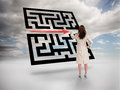 Businesswoman drawing red arrow through qr code on cloudy background Stock Photo