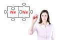 Businesswoman drawing a Win Win Puzzle Concept on the virtual screen. Royalty Free Stock Photo