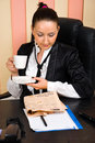 Businesswoman drink coffee and read the news Royalty Free Stock Photo