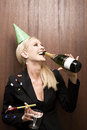 Businesswoman drinking champagne Royalty Free Stock Photo